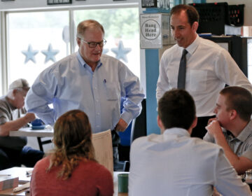 Scott Wagner and Jeff Bartos campaign at a diner in 2018
