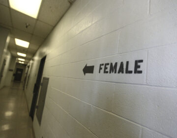 A sign points toward the women's section of the Huntington Beach jail