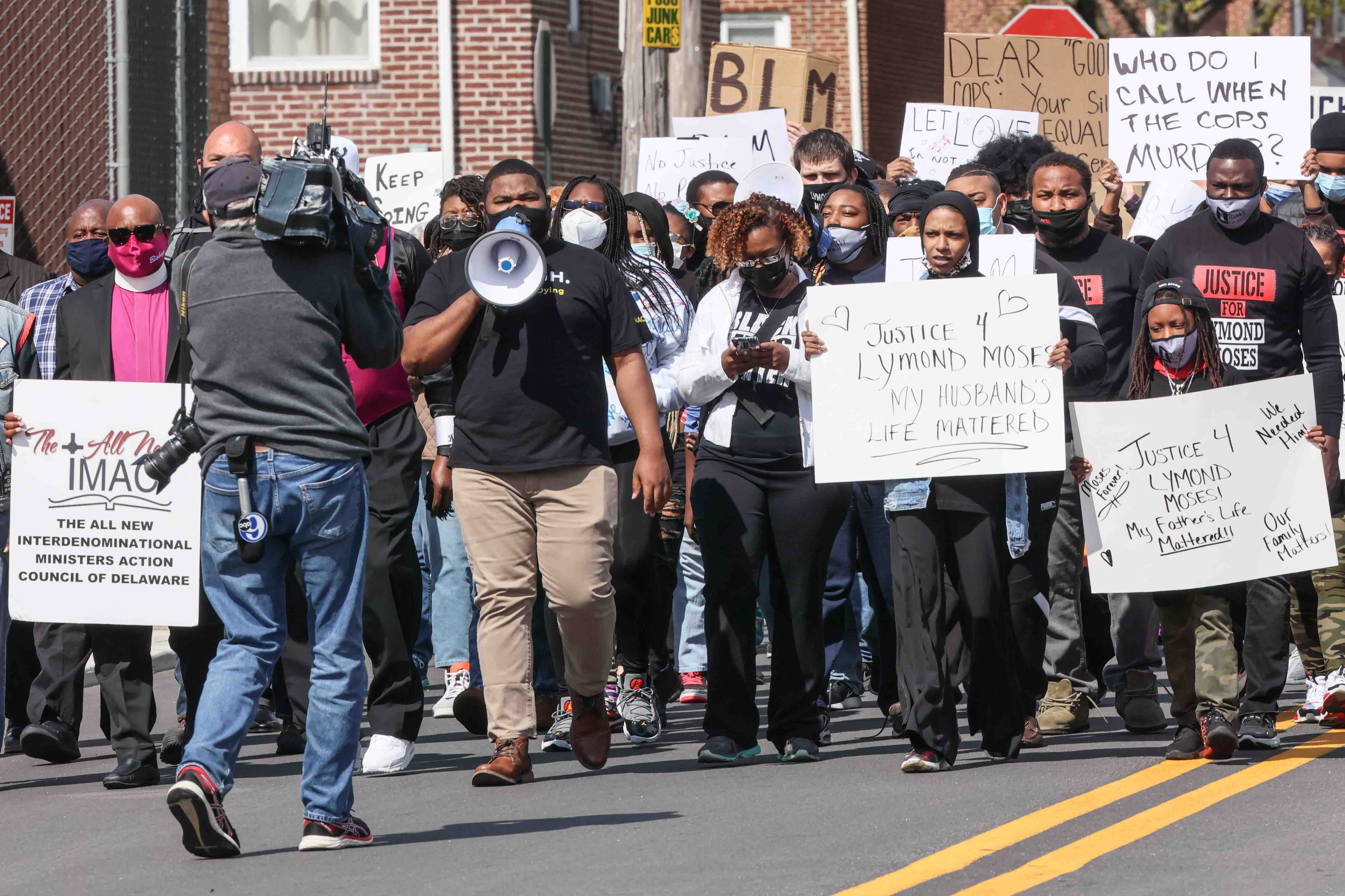 Community organizer Coby Owens leads members of the community on a march to Rodney Square during a We Still Can't Breathe March Against Police Brutality