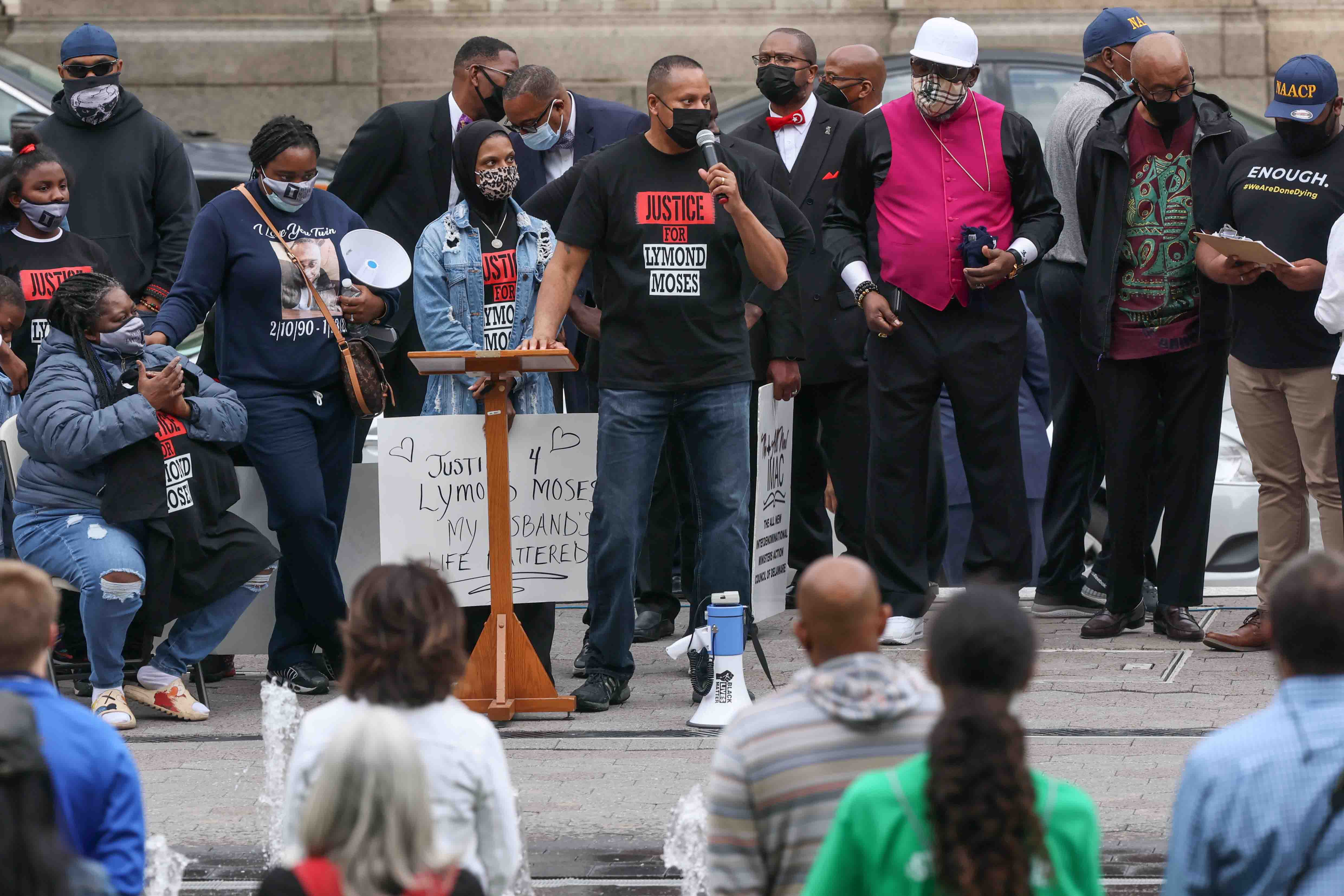 Community activists and former police officer Terence Jones give remarks during a We Still Can't Breathe March