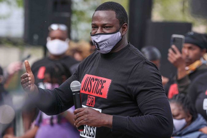 Emeka Igwe, president of The Igwe Firm, gives remarks during a We Still Can't Breathe March