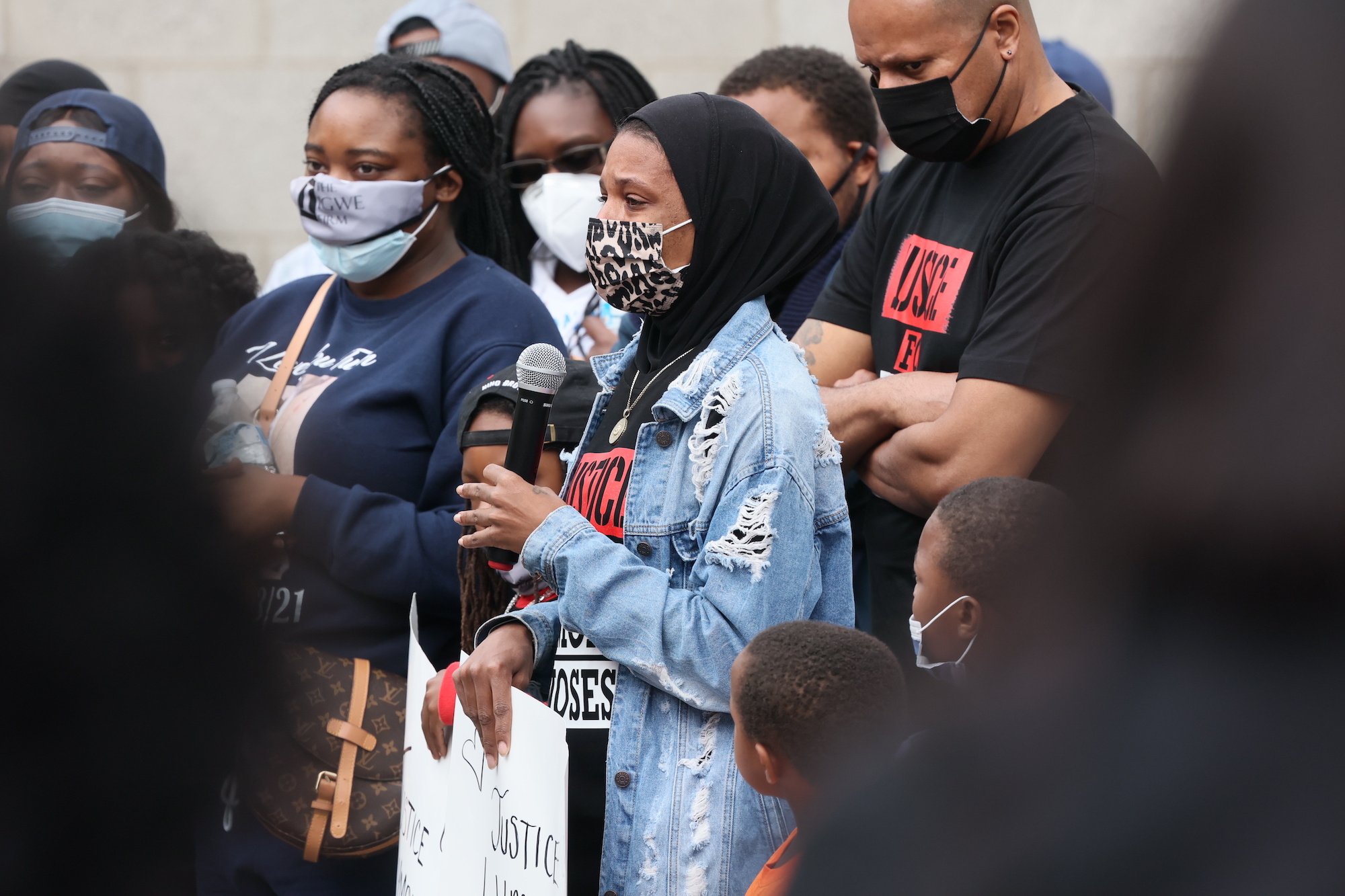 Lymond Moses widow Amanda Spence gives remarks during a We Still Can't Breathe March Against Police Brutality