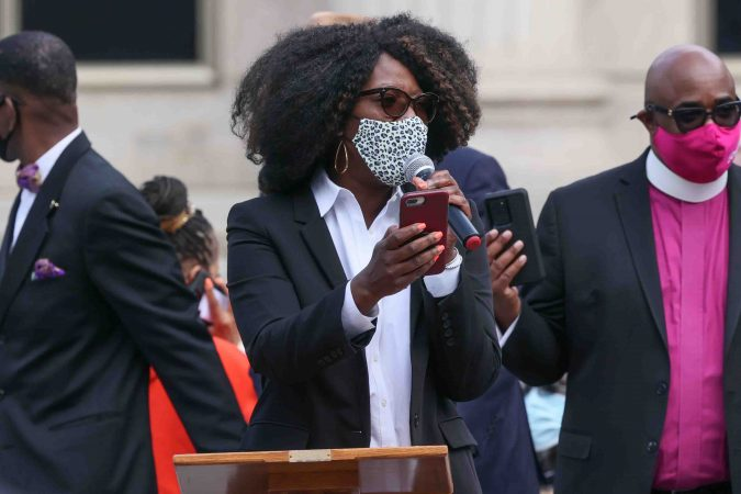 Rep. Kendra Johnson (D) gives remarks during a We Still Can't Breathe March