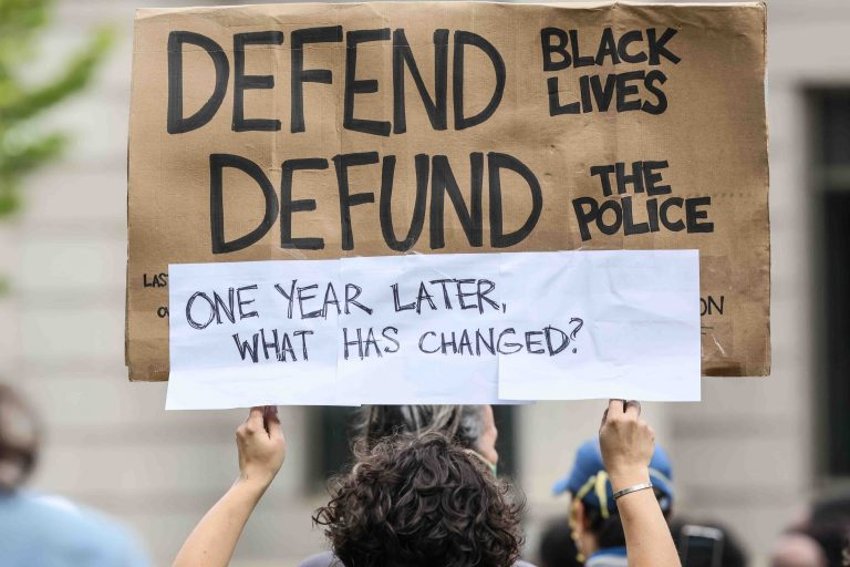 A protester holds up a sign during a We Still Can't Breathe March