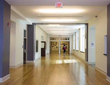A student walks through the halls of Cardozo High School