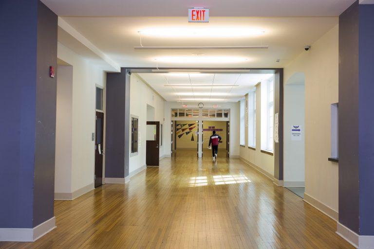 A student walks through the halls of Cardozo High School
