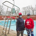 Thelma Nesbitt (left) and Margaret Fredlund stand beside a pool