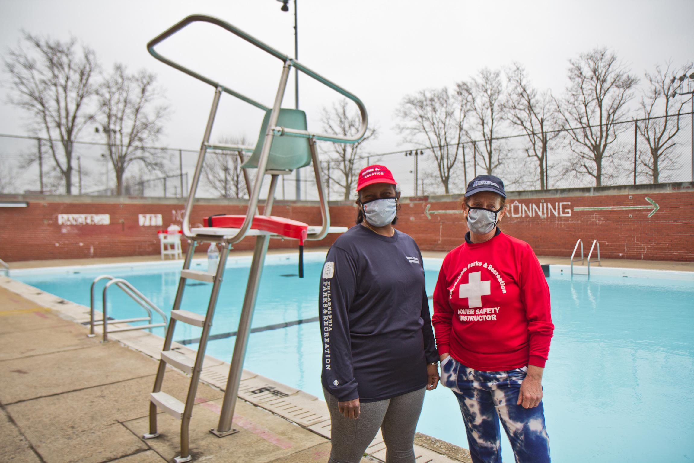 Thelma Nesbitt (left) and Margaret Fredlund stand beside a pool