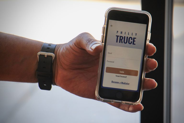 Philly Truce is an app that connects troubled neighborhoods with trained mediators who can calm disputes before they erupt in violence. (Emma Lee/WHYY)