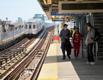 Passengers wait at the Somerset Station on the Market-Frankford line. (Emma Lee/WHYY)
