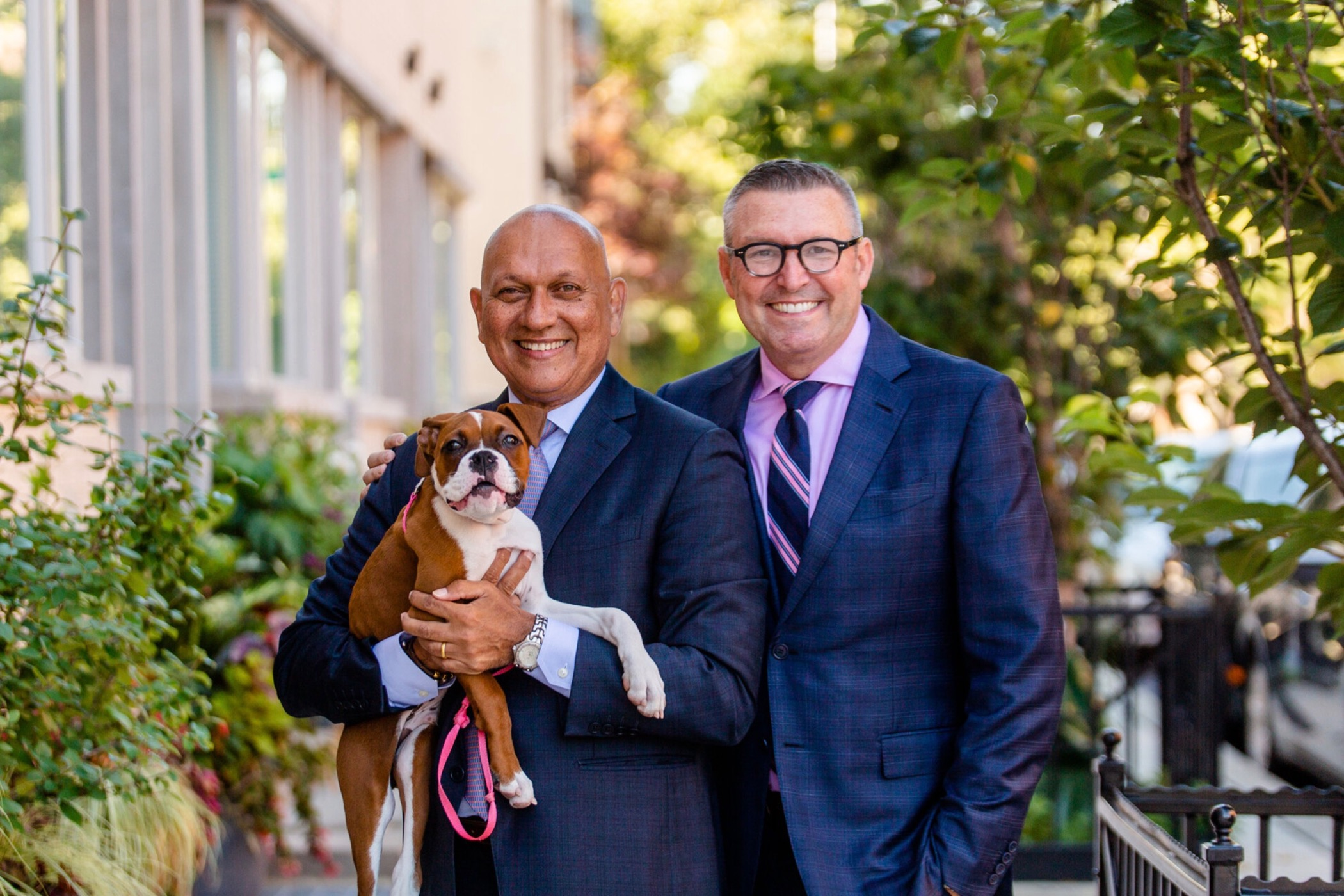 Emergency room Dr. Kevin Baumlin (right) pictured with his husband Patrick and their boxer Duke