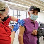 Eduardo Delgado, 79, gets his COVID-19 vaccination from Gail Bagnato