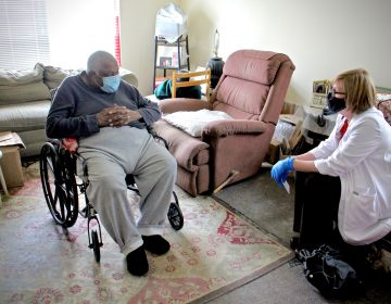 Rebecca Bryan of Rutgers School of Nursing sits with 86-year-old Turner Pittman