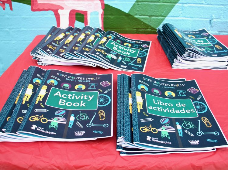 Activity books aimed at children in Pre-K through 5th grade will be used to bring the Safe Routes Philly program to William Cramp and other elementary schools. (Emma Lee/WHYY)