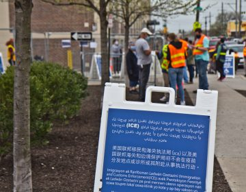 Signs in multiple languages inform vaccine seekers that ICE will not around the Esperanza COIVD-19 vaccine in North Philadelphia. (Kimberly Paynter/WHYY)