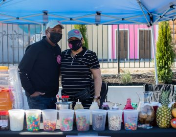 Alexie Encarnación and Yaritza Román of Northeast Philadelphia run an artisanal ice cream business called Helados Chupi Chupi and are regular vendors at La Placita. (Becca Haydu for WHYY)