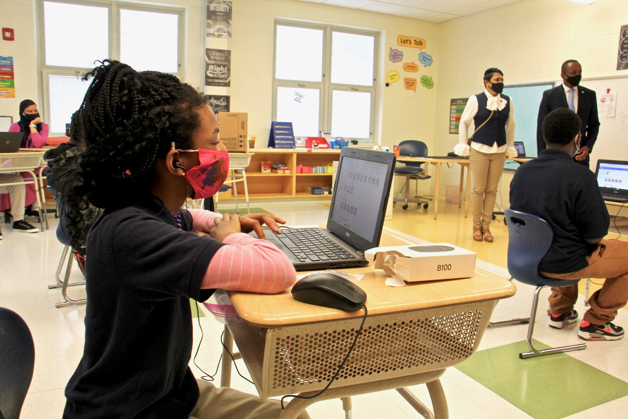 Students settle in at their desks