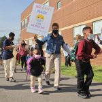 Teachers escort students to H.B. Wilson Elementary School