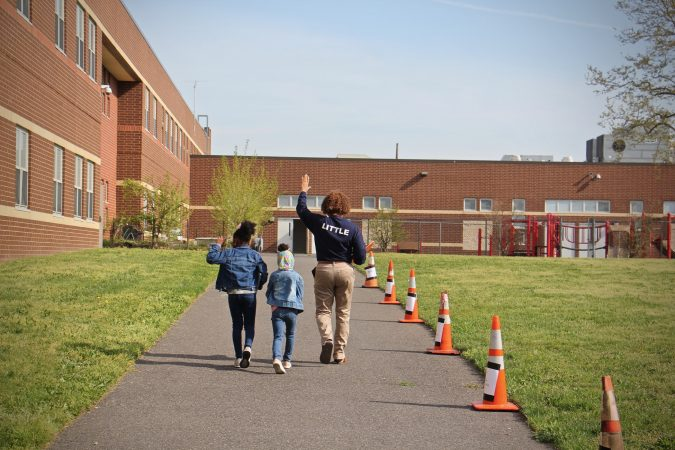 Students are escorted to H.B. Wilson Elementary School