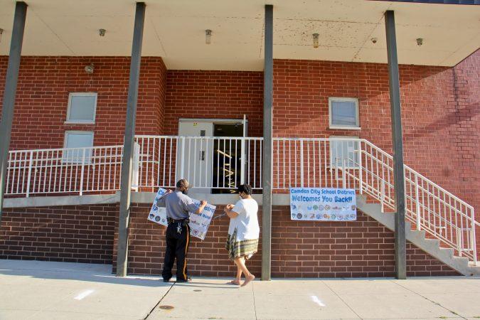 Employees at H.B. Wilson Elementary School in Camden, N.J.