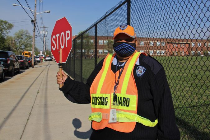 Marcella Vincent holds up a crossing guard sign