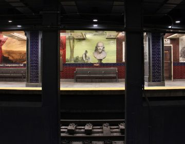 A series of murals by Tom Judd at the 5th Street/Independence Hall stop on the Market-Frankford line. (Emma Lee/WHYY)