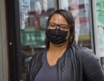 Tiffany Ward, owner of NV My Eyewear on 52nd Street, in front of her store on April 21, 2021. (Kimberly Paynter/WHYY)