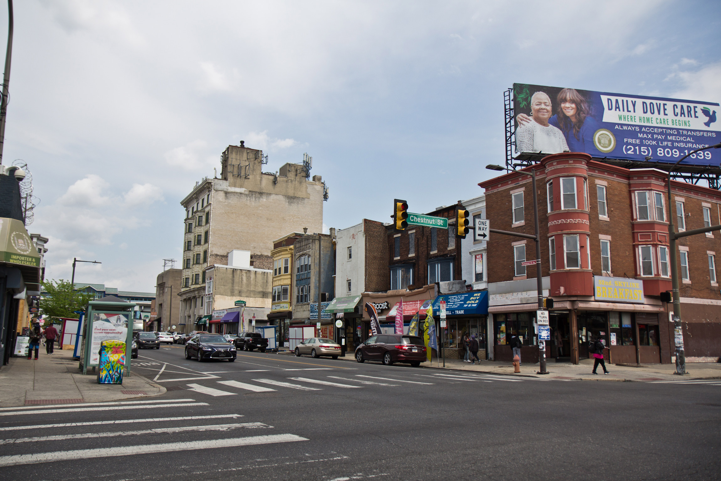 Shops on 52nd Street in West Philadelphia were mostly open the day after the guilty verdict in the trial of Derek Chauvin was delivered on April 21, 2021. (Kimberly Paynter/WHYY)