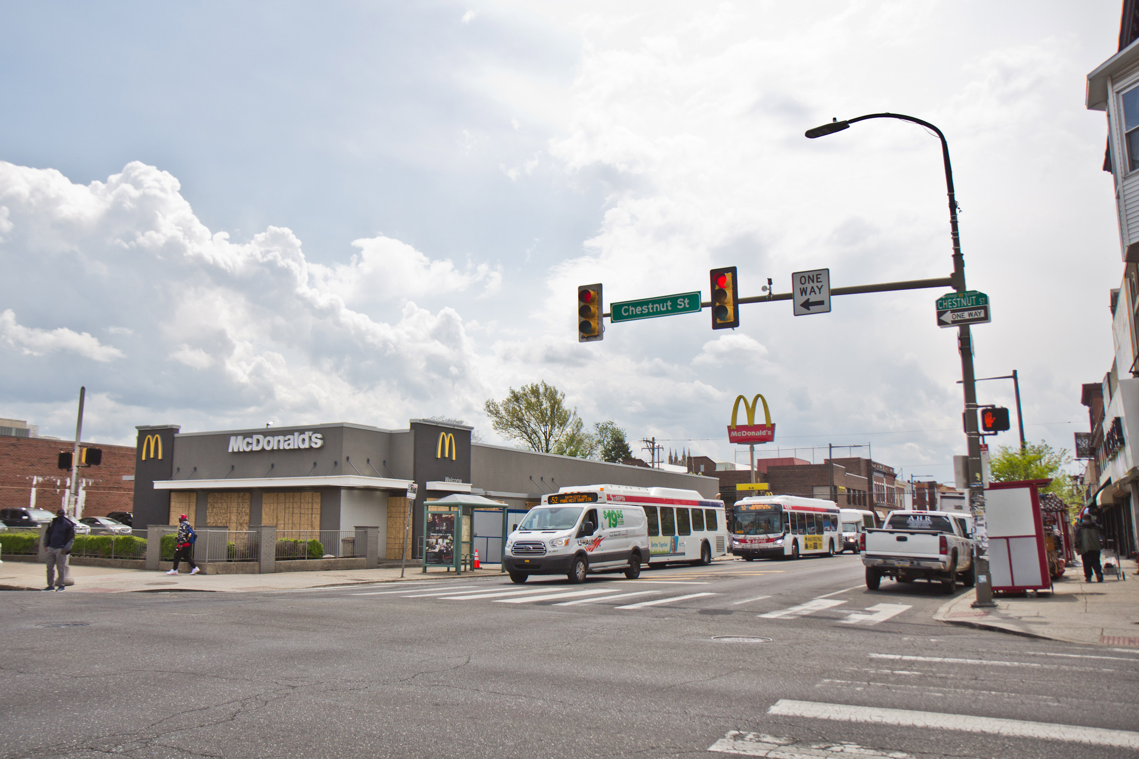 Shops on 52nd Street in West Philadelphia were mostly open on April 21, 2021, the day after the guilty verdict in the trial of Derek Chauvin was delivered. (Kimberly Paynter/WHYY)