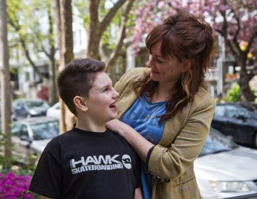 Adrienne Hamilton and her son, Bowie, at their home in Philadelphia. (Kimberly Paynter/WHYY)