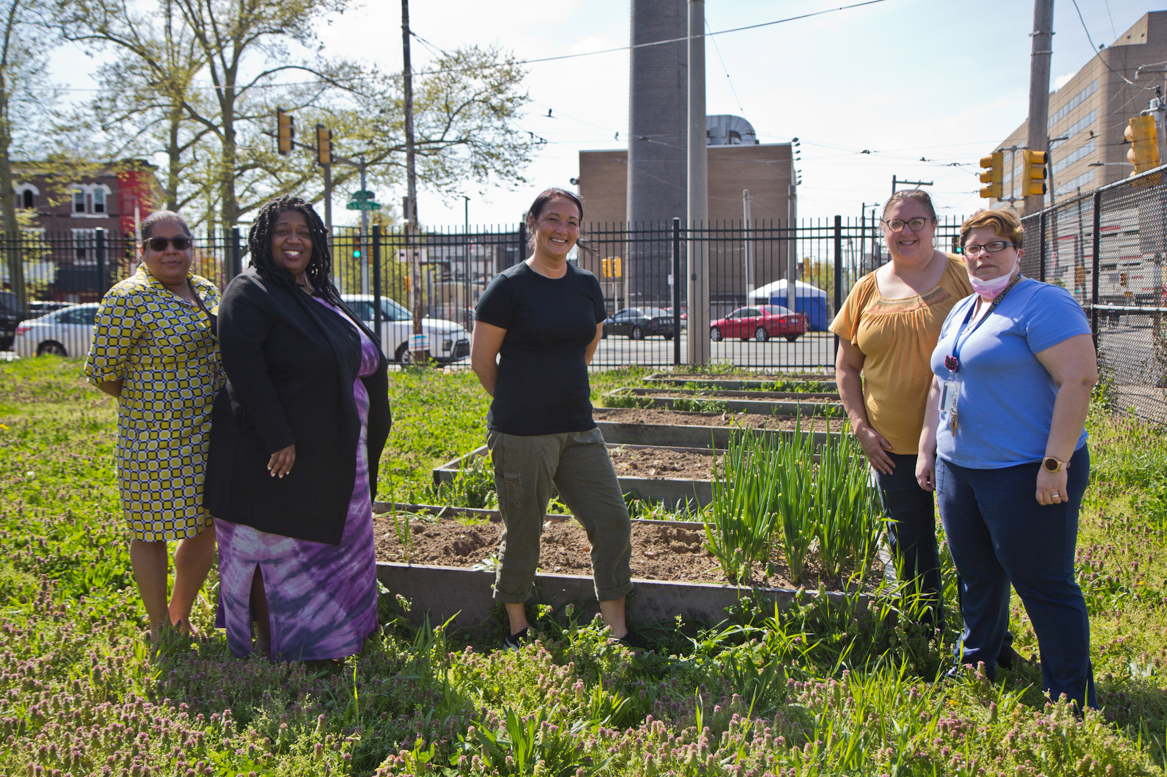 (From left) Assistant principal Yasim Evangelista, principal Aliya Catanch-Bradley, 2nd grade teacher Diane Balanovich, 2nd grade teacher Marianne Marino and Head Start teacher Lena Quiroz stand with the flower boxes they built at Mary McLeod Bethune Elementary. (Kimberly Paynter/WHYY)