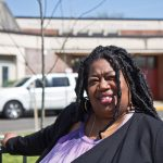 Mary McLeod Bethune Elementary Principal Aliya Catanch-Bradley stands in front of trees planted in Fall 2020. (Kimberly Paynter/WHYY)