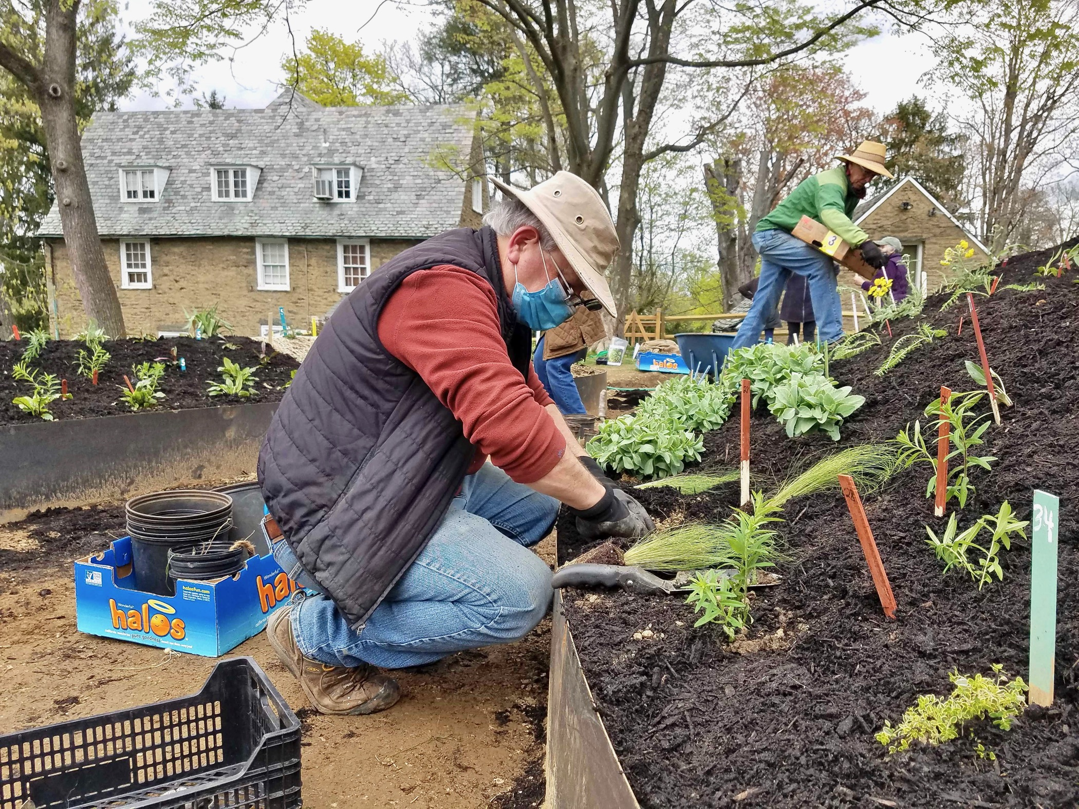 Mark Klempner helps to plant a hugel mound at the Woodmere Art Museum