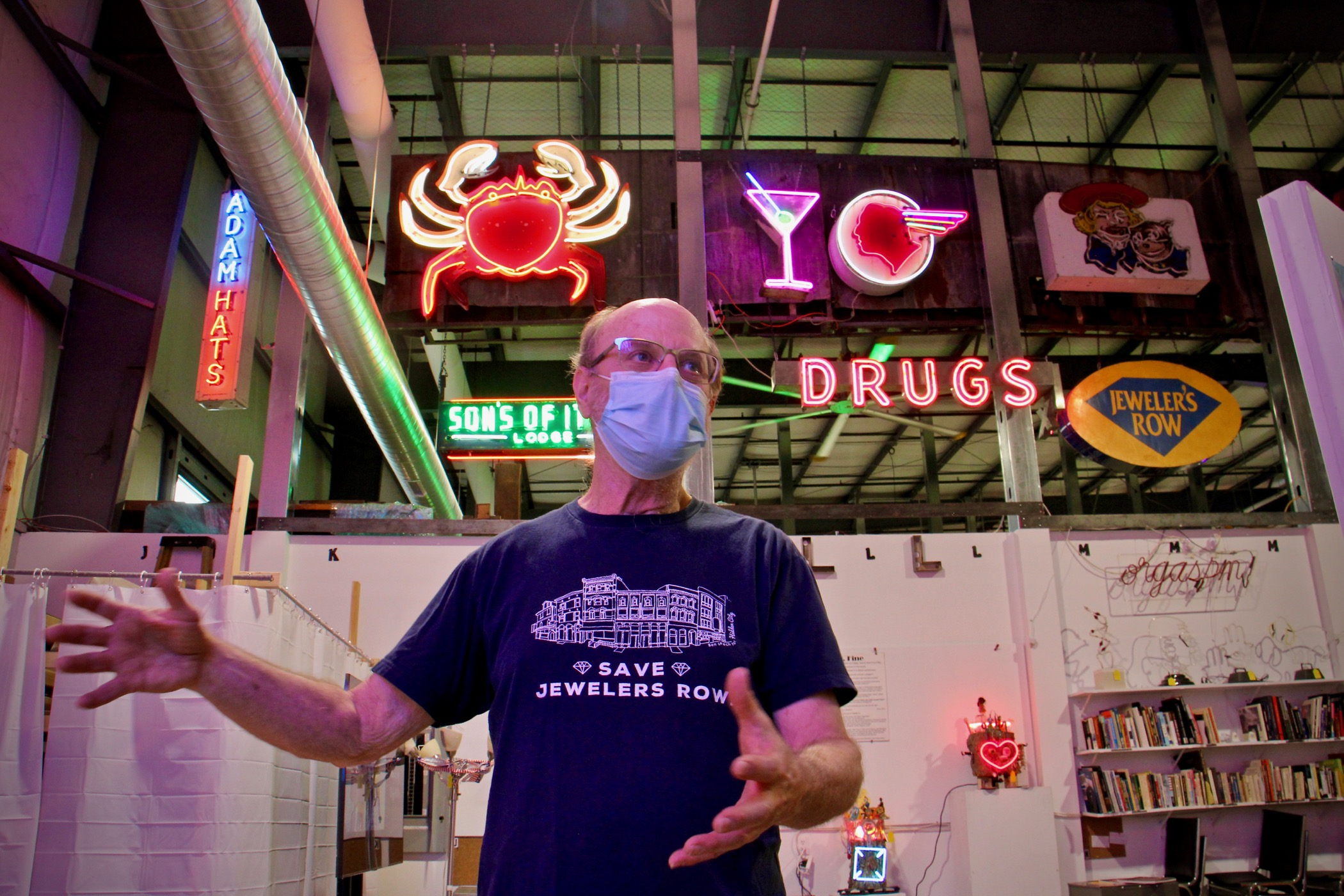 Len Davidson leads a tour of the Neon Museum of Philadelphia, housed in the NexFab Building in Kensington. (Emma Lee/WHYY)