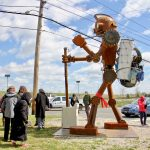 ''Mechan 11: The Collector'' was installed in North Camden's Cramer Hill Neighborhood. The heart for the 15-foot-tall robot was designed by a Camden high school student and then fabricated by Tyler Fuqua Creations. (Emma Lee/WHYY)