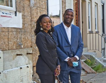 Sandra Dungee Glenn and Anthony Fullard in front of a West Philly property