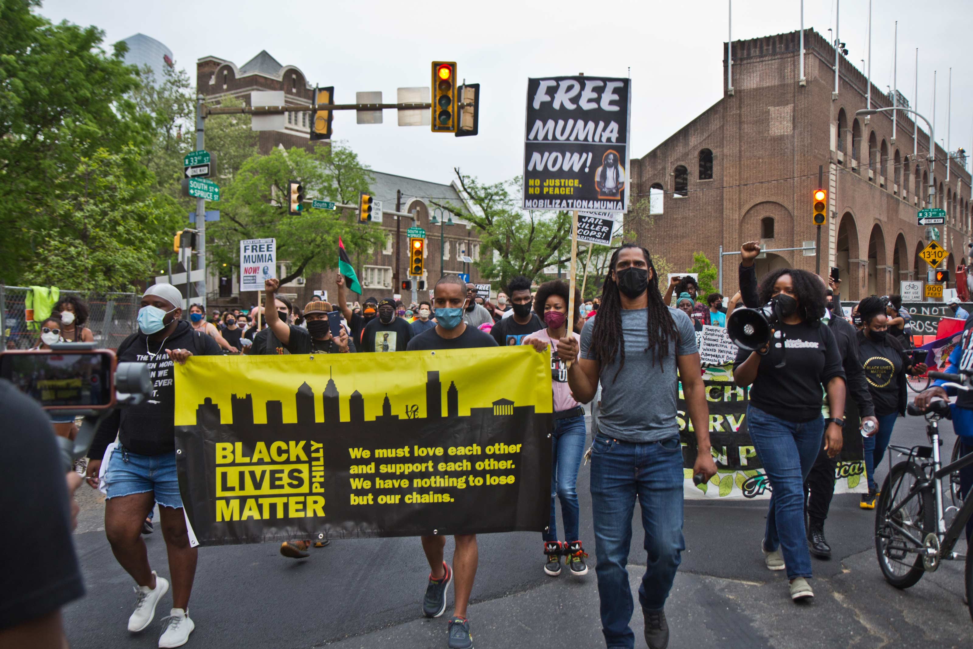 Protesters marched on the University of Pennsylvania's campus on April 28, 2021, over Penn Museum's mistreatment of the remains of children Tree and Delisha Africa who were killed when the city bombed MOVE's headquarters in 1985. (Kimberly Paynter/WHYY)