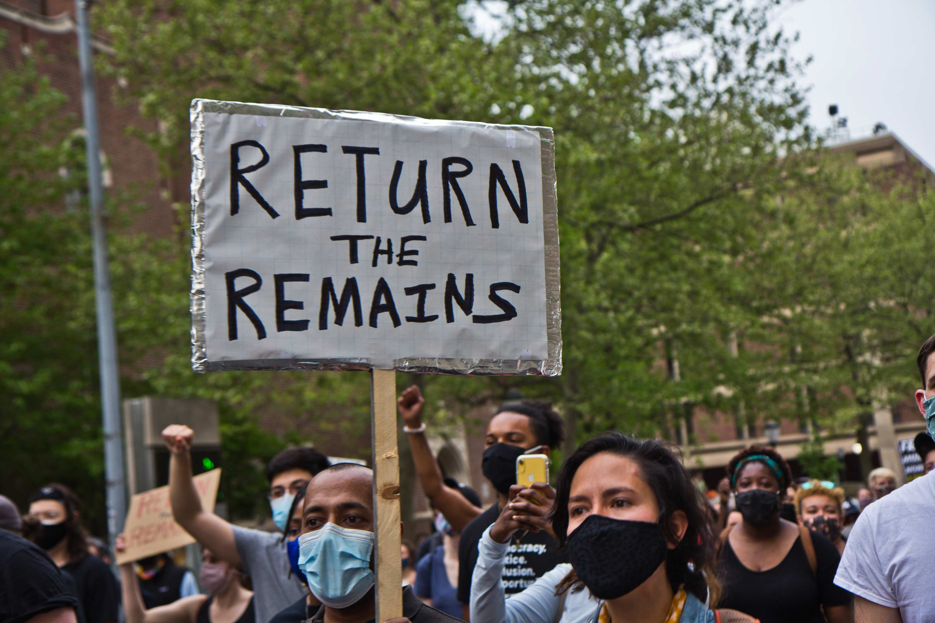 Protesters marched on the University of Pennsylvania's campus on April 28, 2021, over Penn Museum's mistreatment of the remains of children Tree and Delisha Africa who were killed when the city dropped explosives on MOVE's headquarters in 1985. (Kimberly Paynter/WHYY)