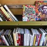 Free books are available from Tree House Books' mobile library, parked at a community event at Urban Creators on North 11th Street in Philadelphia on April 7, 2021. (Kimberly Paynter/WHYY)