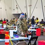 Members of the National Guard administer COVID-19 vaccines at the Esperanza Community Vaccination Center in North Philadelphia on April 9, 2021. (Kimberly Paynter/WHYY)