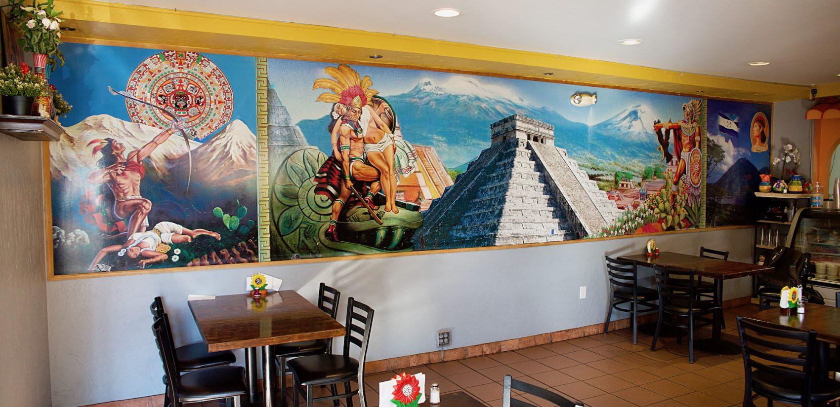 The inside of Tamalex, David Piña's restaurant, is covered in bright murals paying homage to his Mexican culture. | El interior de Tamalex, el restaurante de David Piña, está cubierto de murales brillantes que celebran a su cultura mexicana. (Tony Rocco/WHYY)