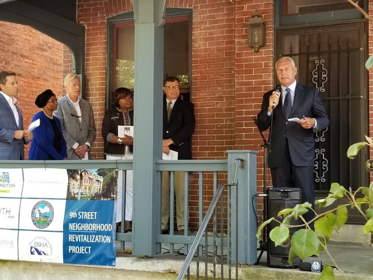 Bill Freeborn (third from left) observes as Mayor Mike Purzycki talks about a Land Project in Wilmington in 2019. (City of Wilmington)