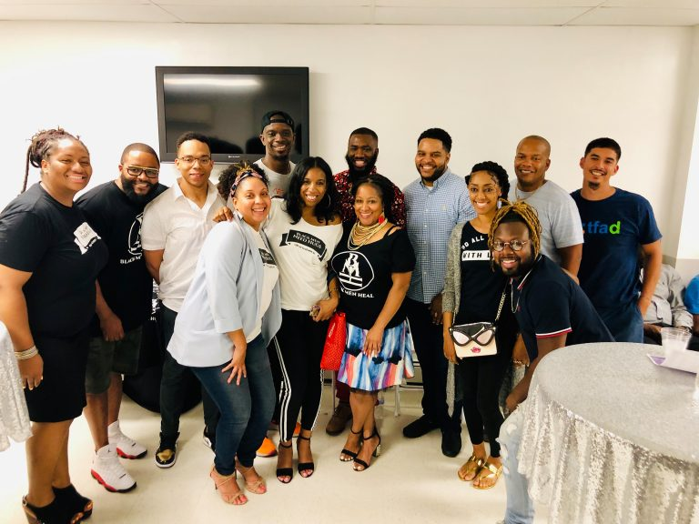 A mix of providers, board members, and clients from Black Men Heal.