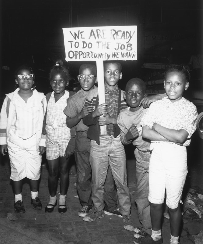 "A photo from Jack T. Franklin's AAMP collection shows young Black boys with a sign that says, ""We are ready to do the job"""