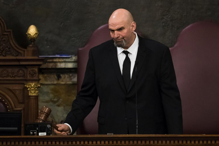 Lt. Gov. John Fetterman gavels in a joint session of the Pennsylvania House and Senate before Democratic Gov. Tom Wolf delivers his budget address for the 2019-20 fiscal year, Harrisburg, Pa., Tuesday, Feb. 5, 2019. (AP Photo/Matt Rourke)