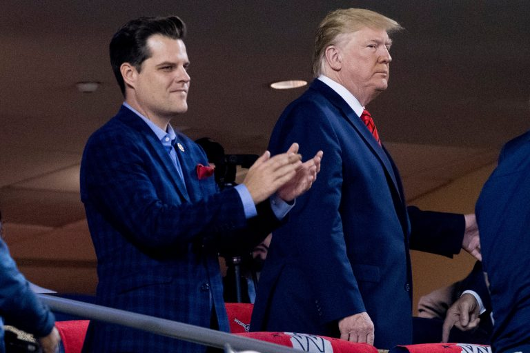 In this Oct. 27, 2019, file photo President Donald Trump, right, accompanied by Rep. Matt Gaetz, R-Fla., left, arrive for Game 5 of the World Series baseball game between the Houston Astros and the Washington Nationals at Nationals Park in Washington. (AP Photo/Andrew Harnik)