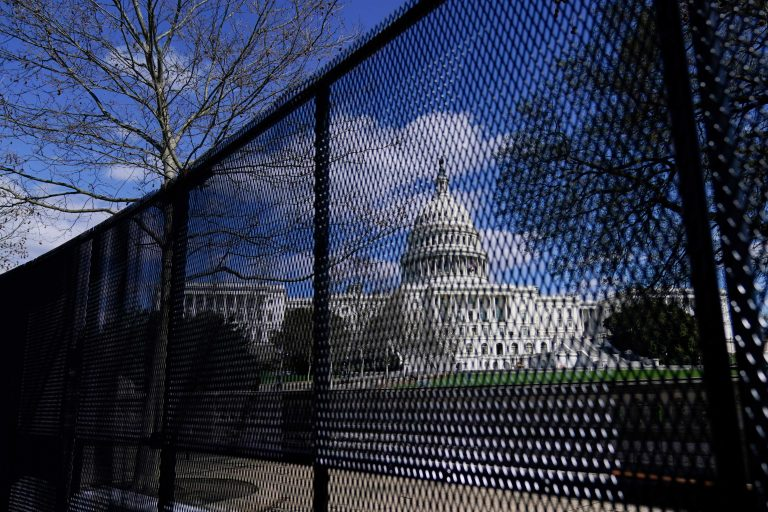 The U.S. Capitol is seen behind security fencing after a car that crashed into a barrier on Capitol Hill in Washington, Friday, April 2, 2021.