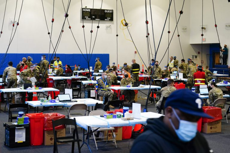 Members of the military inoculate people with the Johnson & Johnson COVID-19 vaccine at the Esperanza Community Vaccination Center in Philadelphia, Friday, April 9, 2021. (AP Photo/Matt Rourke)