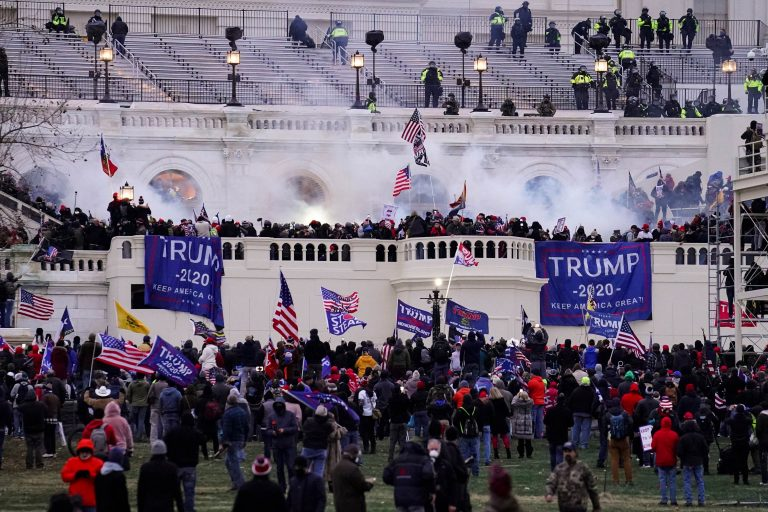 In this Wednesday, Jan. 6, 2021, file photo, violent rioters storm the Capitol, in Washington. New details from the deadly riot of Jan. 6 are contained in a previously undisclosed document prepared by the Pentagon for internal use that was obtained by the Associated Press and vetted by current and former government officials. (AP Photo/John Minchillo)