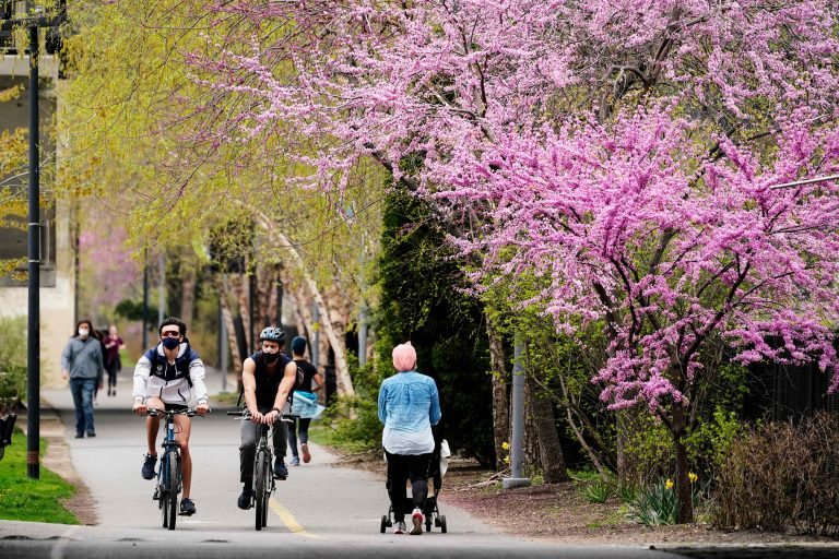 People move along the Schuylkill River Trail
